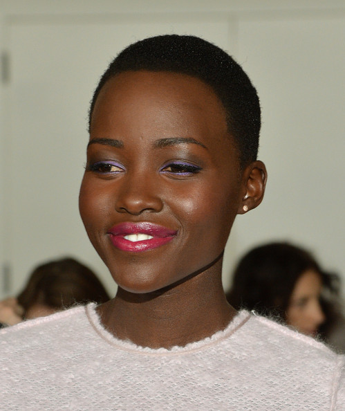Lupita Nyong'o attends the Calvin Klein Collection fashion show during Mercedes-Benz Fashion Week Fall 2014 at Spring Studios on February 13, 2014 in New York City