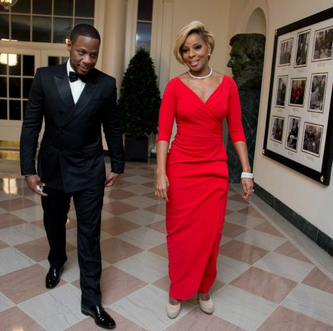 Singer Mary J. Blige, and Kendu Isaacs, left, arrive for a State Dinner in honor of French President François Hollande, at the White House in Washington D.C.
