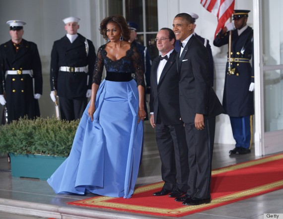 President Barack Obama, First Lady Michelle Obama pose with French President Francois Hollande as he arrives for the State Dinner at the North Portico of the White House on February 11, 2014 in Washington, DC.