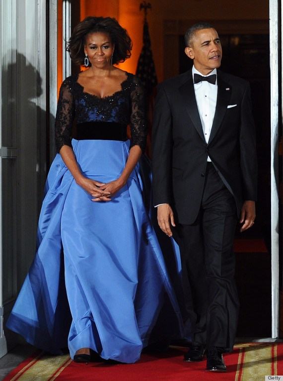 President Barack Obama and First Lady Michelle Obama arrive to welcome French President Francois Hollande for a state dinner at the White House in Washington, DC, on February 11, 2014.