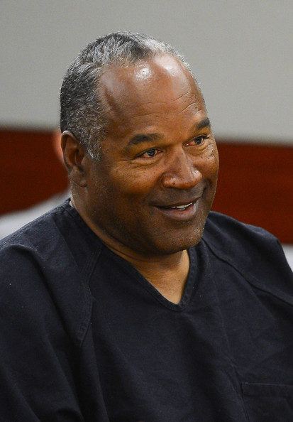 O.J. Simpson smiles during an evidentiary hearing in Clark County District Court on May 17, 2013 in Las Vegas, Nevada