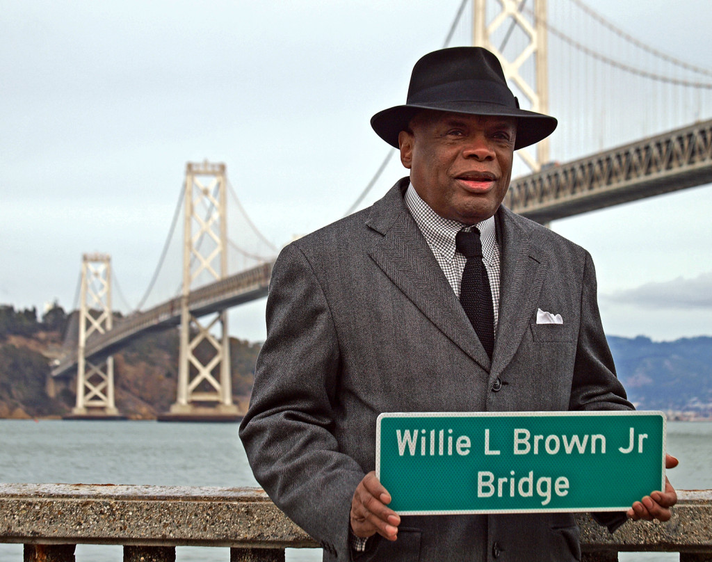 Former speaker of the California Assembly and former San Francisco Mayor, Willie L. Brown, holds a sign that now officially hangs on the western span of the Bay Bridge. Any questions?
