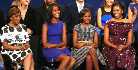 (L-R)  Marian Robinson, Malia Obama, Sasha Obama, First lady Michelle Obamaspeaks on stage during the final day of the Democratic National Convention at Time Warner Cable Arena on September 6, 2012 in Charlotte, North Carolina.