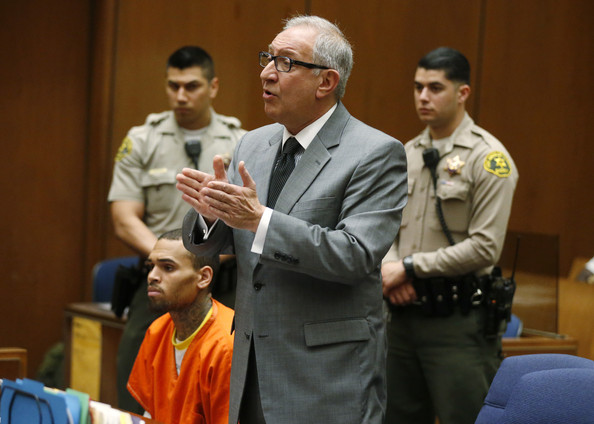 R&B singer Chris Brown (L) appears in court with his attorney Mark Geragos for a probation violation hearing during which his probation was revoked by a Los Angeles Superior judge on March 17, 2014 in Los Angeles, California.