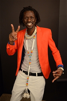 We Are Family Foundation Honoree Emmanuel Jal flashes peace sign.  (Photo by Shahar Azran/FilmMagic