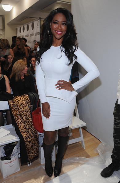 Reality star Kenya Moore attends the Michael Costello fashion show at Helen Mills Event Space on February 8, 2014 in New York City