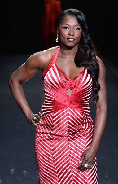 Actress Rutina Wesley, wearing Max Azria, walks the runway at Go Red For Women - The Heart Truth Red Dress Collection 2014 Show Made Possible By Macy's And SUBWAY Restaurants at The Theatre at Lincoln Center on February 6, 2014 in New York City