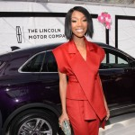 Brandy Norwood with the Lincoln MKC.