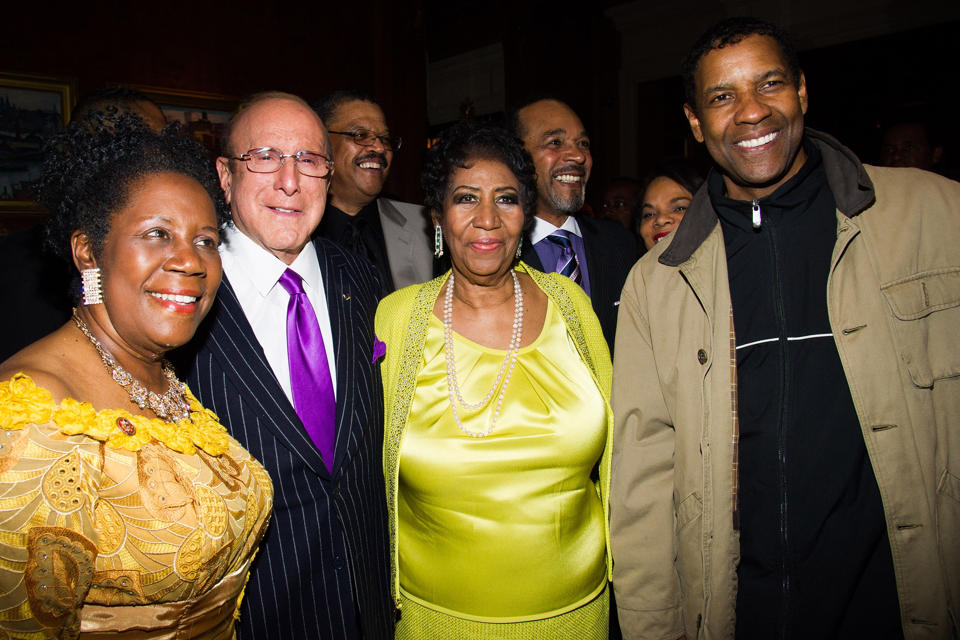 From left, Rep. Sheila Jackson Lee, Clive Davis, Aretha Franklin and Denzel Washington attend Aretha's 72nd birthday celebration on Saturday, March 22, 2014 in New York.