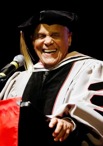 Harry Belafonte laughs while speaking after receiving an honorary doctor of music from Berklee College of Music at the Berklee Performance Center in Boston, Thursday, March 6, 2014