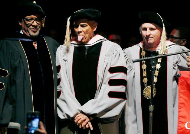 Harry Belafonte, second from left, playfully sticks out his tongue after receiving an honorary doctor of music degree from Berklee College of Music President Roger H. Brown, right, at the Berklee Performance Center in Boston, Thursday, March 6, 2014.
