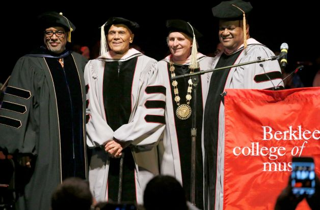 Harry Belafonte, center left, stands with Berklee College of Music President Roger H. Brown, center right, after receiving an honorary doctor of music degree at the Berklee Performance Center in Boston, Thursday, March 6, 2014