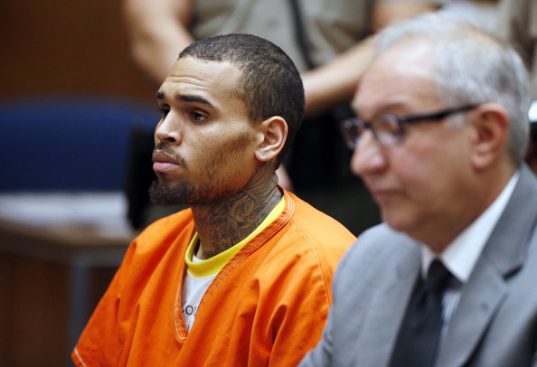 Chris Brown (L) appears in court with his attorney Mark Geragos for a probation violation hearing during which his probation was revoked by a Los Angeles Superior judge on March 17, 2014 in Los Angeles, California.
