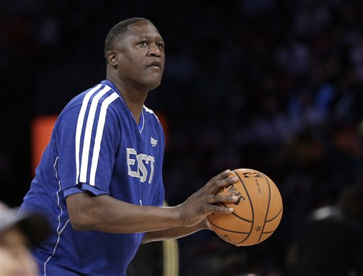 Former NBA player Dominique Wilkins competes in the shooting stars competition during NBA All-Star Saturday Night basketball Saturday, Feb. 16, 2013, in Houston.