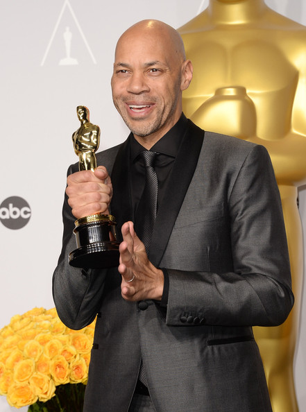 Writer John Ridley, winner of Best Writing, Screenplay Based on Material Previously Produced or Published poses in the press room during the Oscars at Loews Hollywood Hotel on March 2, 2014 in Hollywood, California
