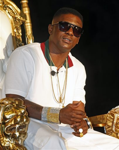 Rapper Lil Boosie, whose real name is Torence Hatch, appears at a news conference in New Orleans, Monday, March 10, 2014.