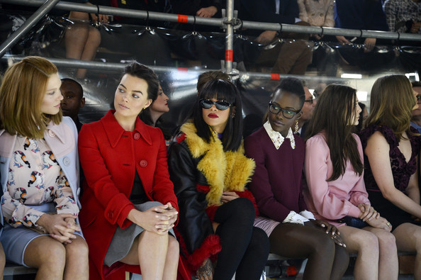 (L-R) Actress Lea Seydoux, Margot Robbie, singer Rihanna, actresses Lupita Nyong'o and Elizabeth Olsen attend the Miu Miu show as part of the Paris Fashion Week Womenswear Fall/Winter 2014-2015 on March 5, 2014 in Paris, France
