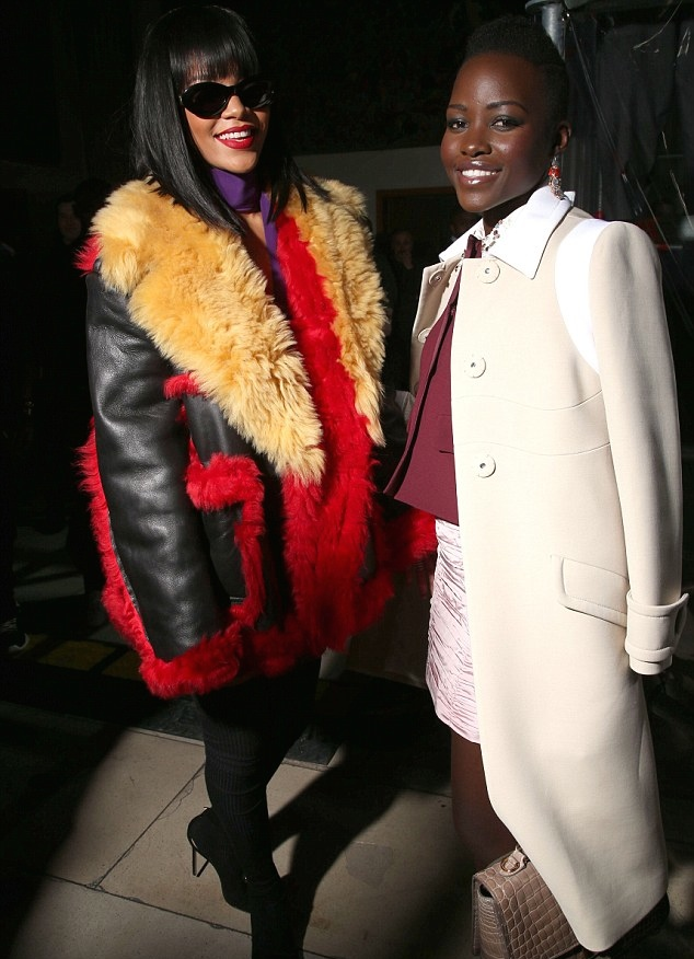 Actress Lupita Nyong'o and singer Rihanna attend the Miu Miu show as part of the Paris Fashion Week Womenswear Fall/Winter 2014-2015 on March 5, 2014 in Paris, France