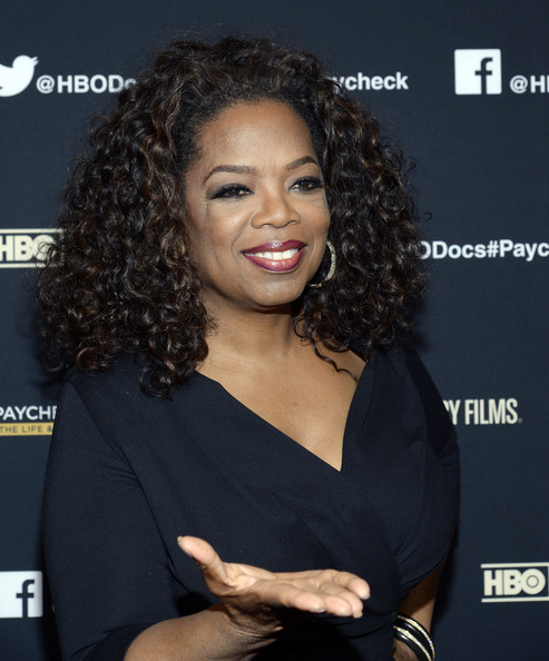 Oprah Winfrey (L) and executive producer Maria Shriver attend the premiere of HBO Documentary Films' 'Paycheck To Paycheck' at Linwood Dunn Theater at the Pickford Center for Motion Study on March 10, 2014 in Hollywood, California