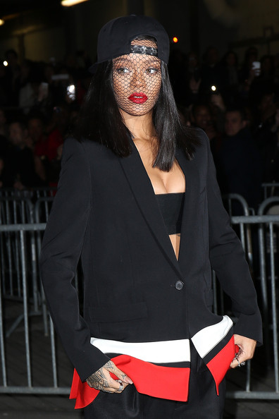 Rihanna attends the Givenchy show as part of the Paris Fashion Week Womenswear Fall/Winter 2014-2015 on March 2, 2014 in Paris, France