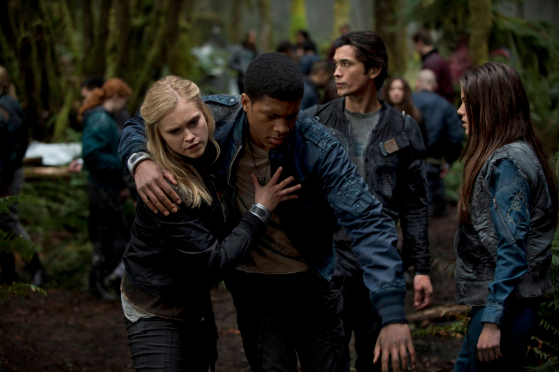 "The 100 --  ""Pilot"" --  (L-R): Eliza Taylor as Clarke, Eli Goree as Wells, Bob Morley as Bellamy, and Marie Avgeropoulos as Octavia"