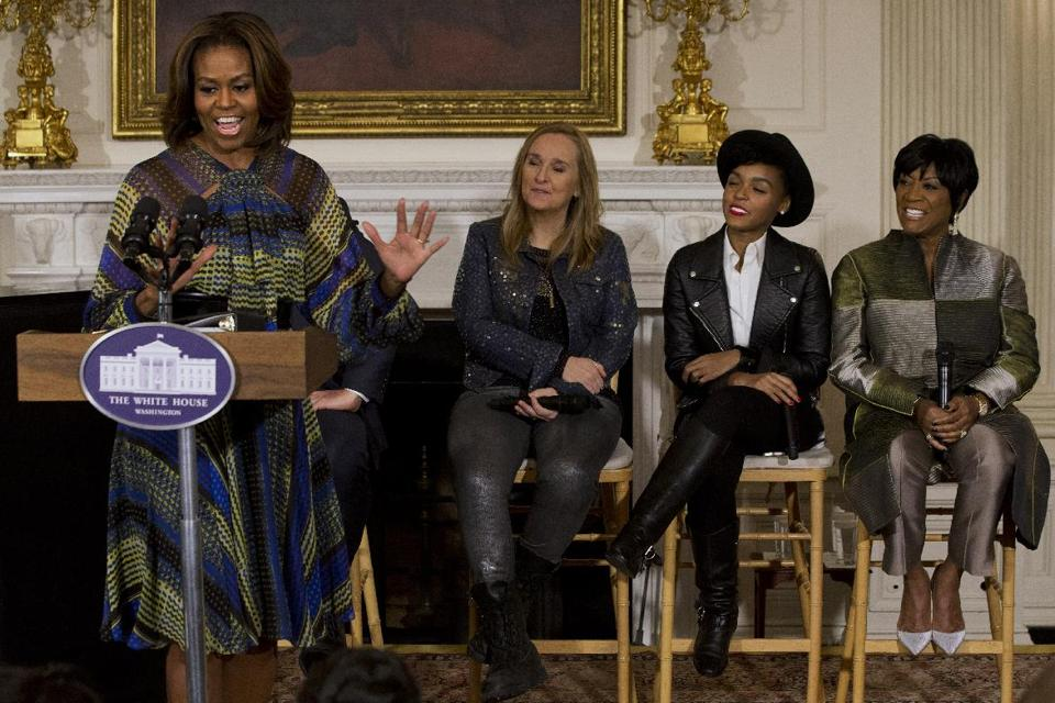 """First lady Michelle Obama speaks in the State Dining Room of the White House in Washington, Thursday, March 6, 2014, with singers, from second from left, Melissa Etheridge, Janelle Monáe, and Patti LaBelle, during a workshop for students as part of the """"In Performance at the White House"""" series"""