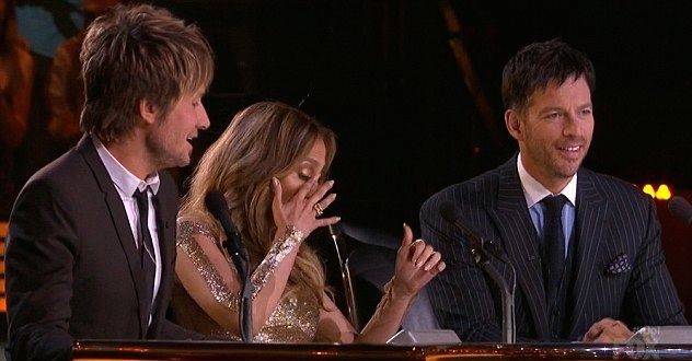 J-Lo (between Keith Urban and Harry Connick Jr.,  wipes away a tear as CJ is eliminated, April 24, 2014