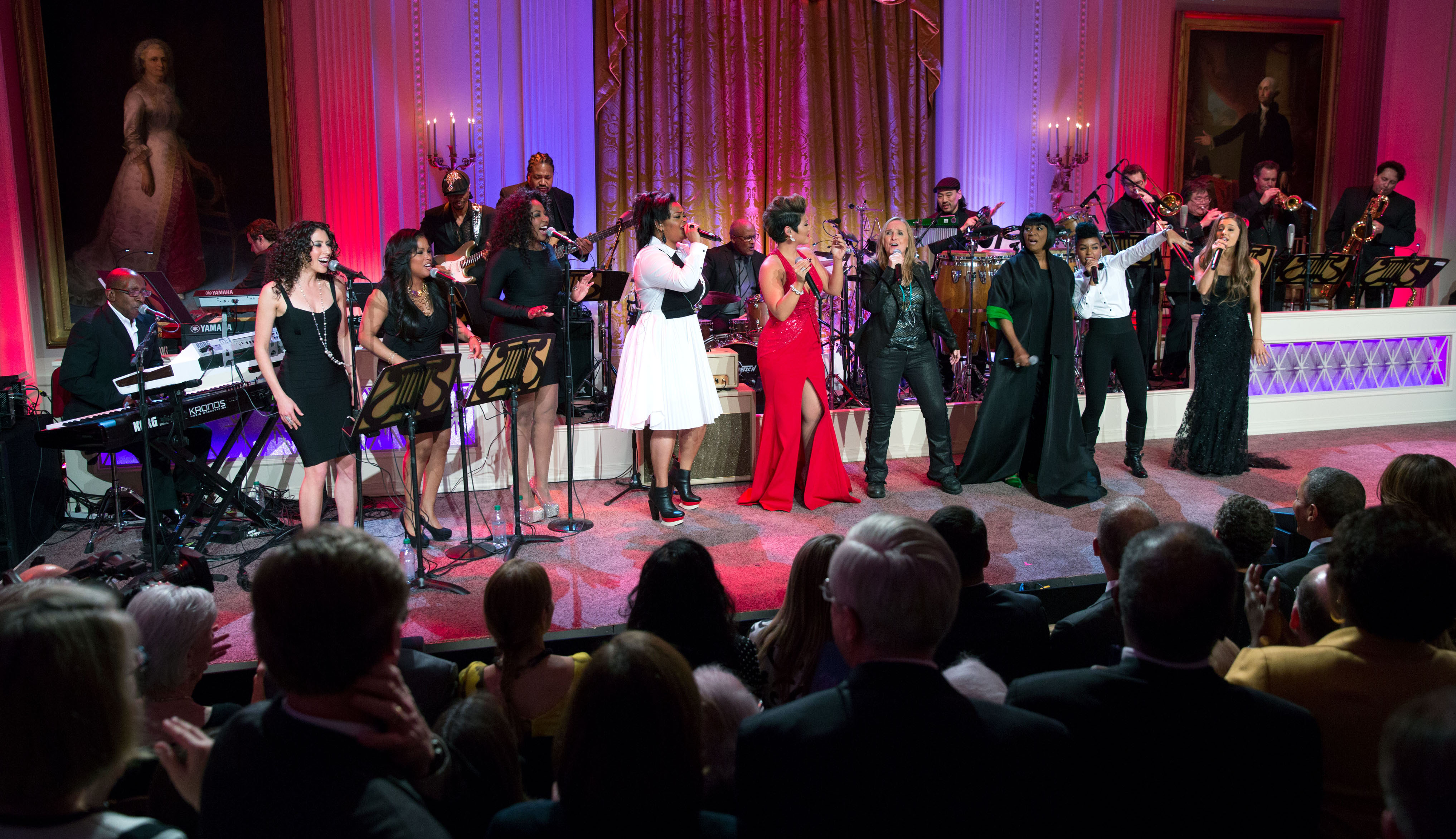"President Barack Obama and First Lady Michelle Obama host ""Women of Soul: In Performance at the White House"" in the East Room of the White House, March 6, 2014. Jill Scott, Tessanne Chin, Melissa Etheridge, Patti LaBelle, Janelle Mon‡e and Ariana Grande perform together on stage."