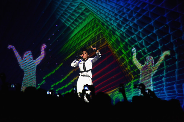 Singer Janelle Monae (C) and a M.I.A. hologram perform during Audi A3 Launch Party with Janelle Monae at Quixote Studios on April 3, 2014 in Los Angeles
