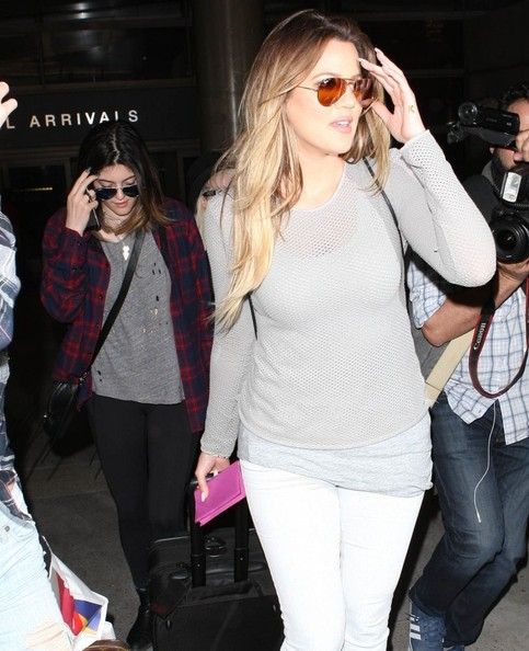 Khloe Kardashian, Kendall Jenner and Kylie Jenner arriving on a flight at LAX airport in Los Angeles, California on April 2, 2014. The Kardashian family had been on a trip to Thailand