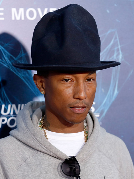 """Musician Pharrell Williams attends """"The Amazing Spider-Man 2"""" premiere at the Ziegfeld Theater on April 24, 2014 in New York City"""
