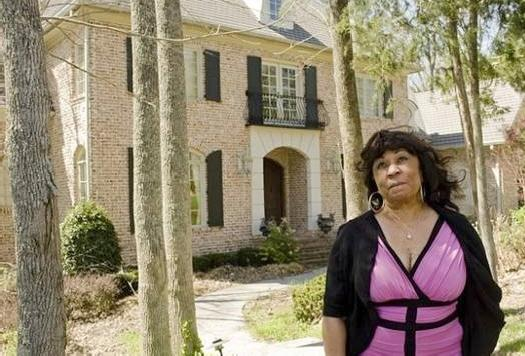 barbara winfrey in front of house