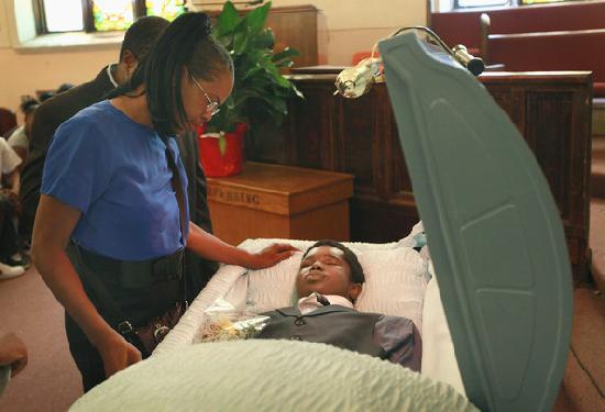 black teen in casket