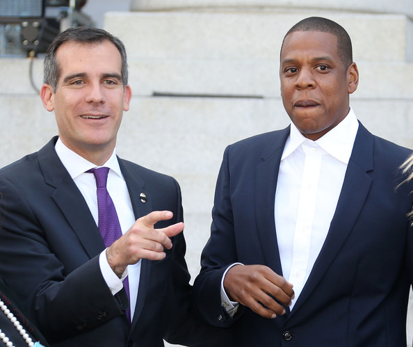 "(L-R) Los Angeles Mayor Eric Garcetti and Recording artist Shawn ""Jay Z"" Carter make an announcement on the Steps of City Hall Downtown Los Angeles for a Labor Day Music Festival at Los Angeles City Hall on April 16, 2014 in Los Angeles, California"