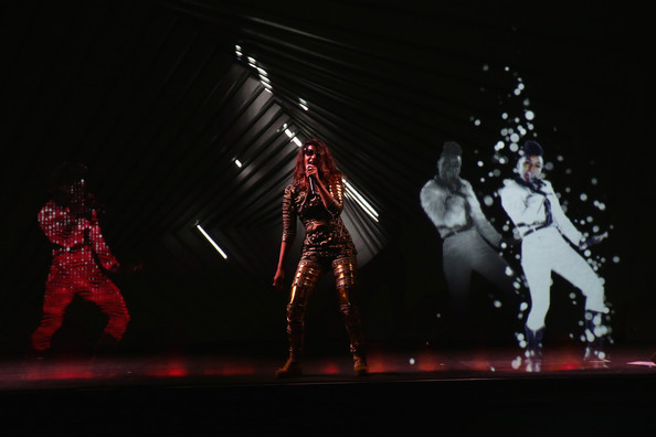 .I.A. and a Janelle Monae hologram perform onstage at the Audi A3 Launch Event with M.I.A. on April 3, 2014 at SIR Stage37 in New York City