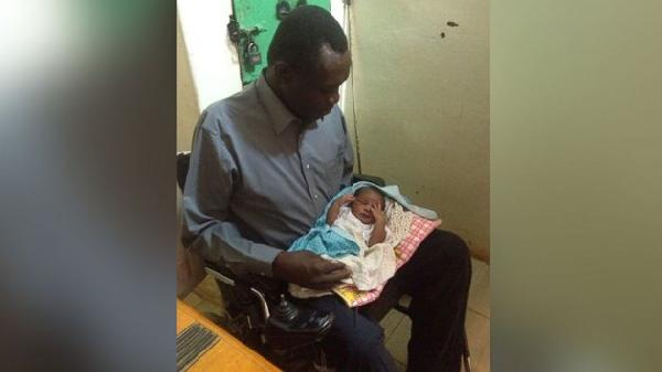 Daniel Wani holds daughter, Maya, for the first time.