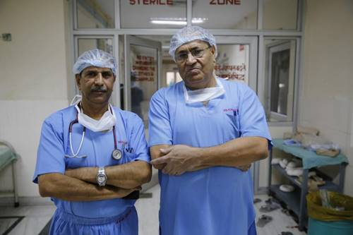 Tanzeel Ur Rehman/Cover Asia Press Dr. Chetan Sharma (right) was joined in the surgical procedure by Dr. Avnish Bharadwaj (left)