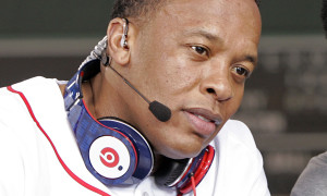 Dr Dre wears a pair of Beats headphones