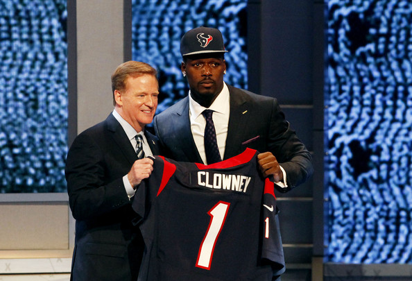 Jadeveon Clowney of the South Carolina Gamecocks stands on stage with NFL Commissioner Roger Goodell after he was picked #1 overall by the Houston Texansduring the first round of the 2014 NFL Draft at Radio City Music Hall on May 8, 2014 in New York City