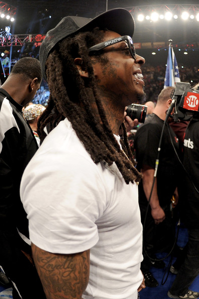 Rapper Lil Wayne in the ring before Floyd Mayweather Jr. takes on Marcos Maidana in their WBC/WBA welterweight unification fight at the MGM Grand Garden Arena on May 3, 2014 in Las Vegas, Nevada