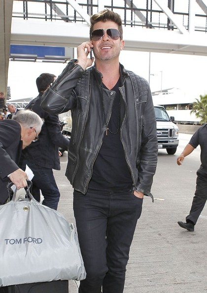 Singer-songwriter Robin Thicke departing on a flight at LAX in Los Angeles, California on April 25, 2014