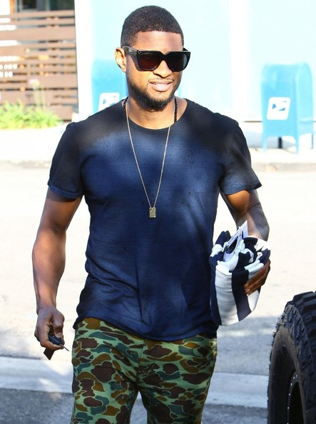 Usher and his girlfriend/manager Grace Miguel seen leaving the Live Nation Music Offices in Beverly Hills, California on May 21, 2014.