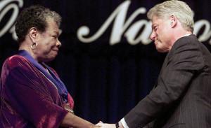 US President Bill Clinton(R) congratulates poet/wr
