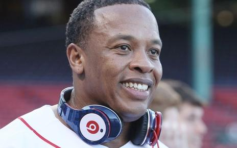 dr dre & headphones around neck