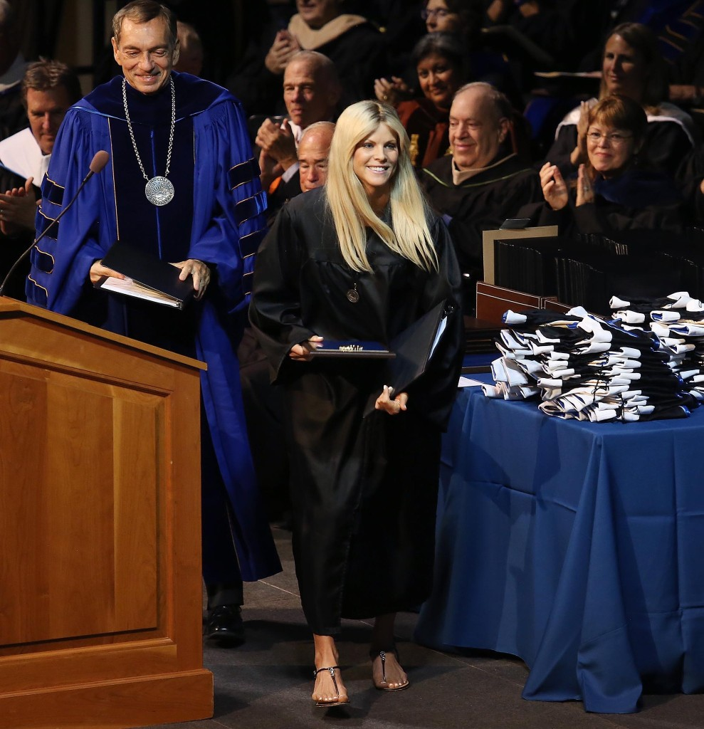 Elin Nordegren walks off the stage after speaking during commencement ceremonies at Rollins College in Winter Park on Saturday, May 10, 2014.
