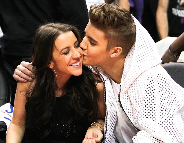 Jusitn Bieber and mother Pattie Mallette attend the game between the Oklahoma City Thunder and the Los Angeles Clippers in Game Four of the Western Conference Semifinals during the 2014 NBA Playoffs at Staples Center on May 11, 2014 in Los Angeles, California