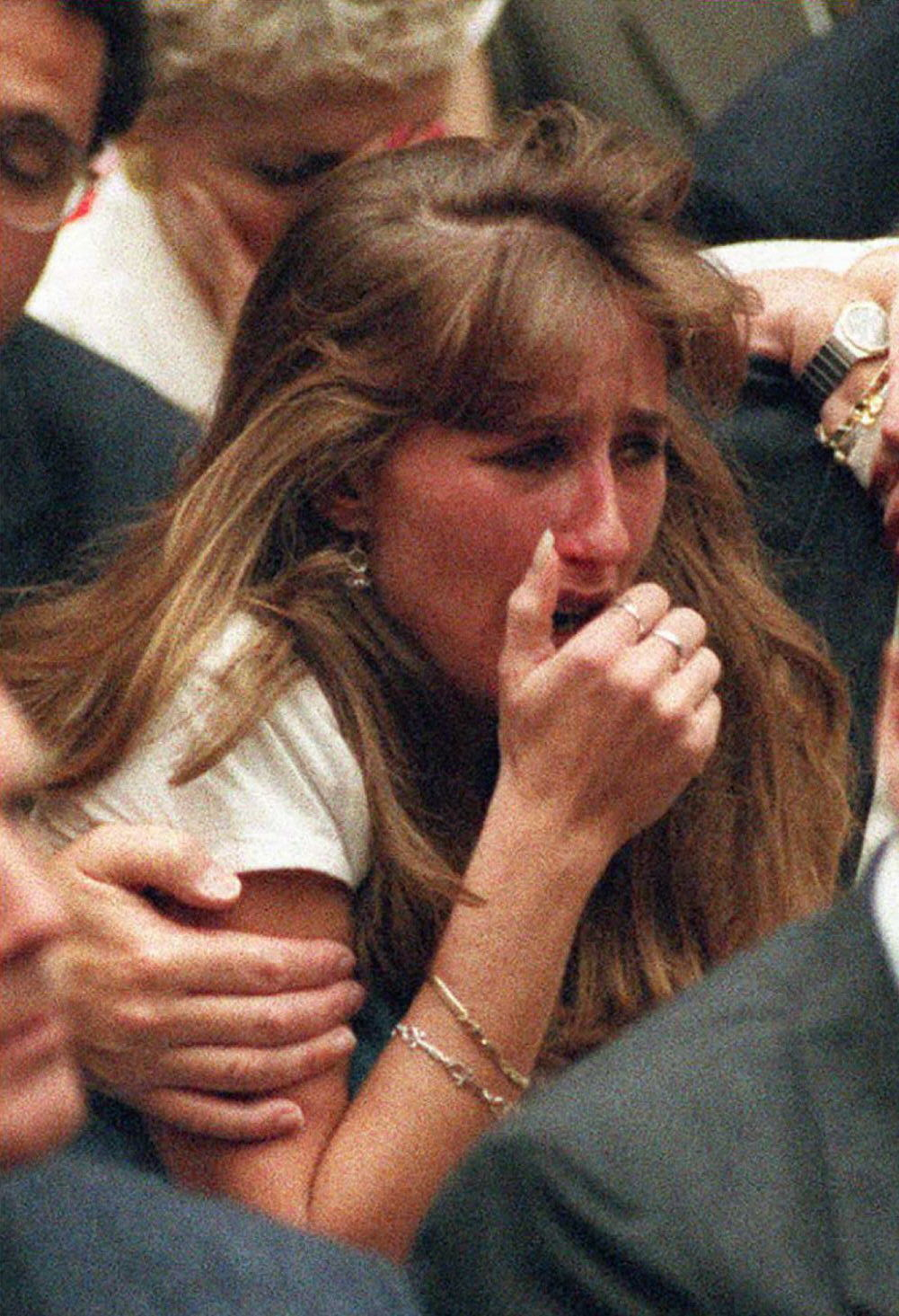 Kim Goldman, the sister of murder victim Ron Goldman, cries after the not guilty verdicts were read in the O.J. Simpson murder trial October 3, 1995 in Los Angeles, California.