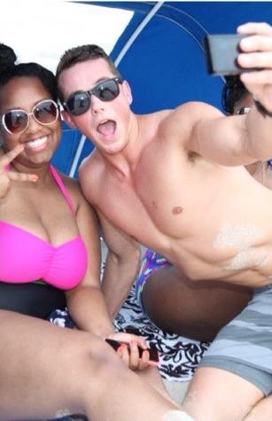 mark miller & black chick take selfie