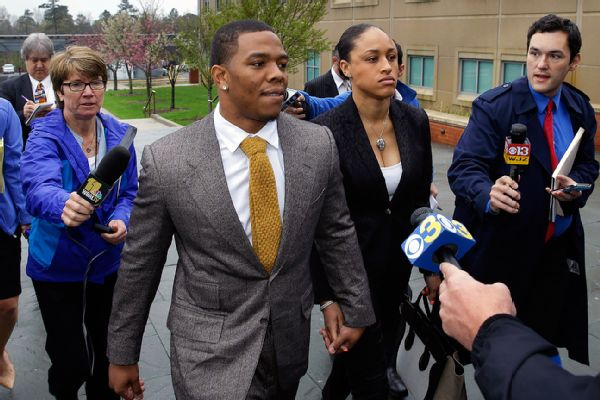 Ray Rice holds hands with his wife, Janay Palmer, as they arrive at the courthouse Thursday, May 1, 2014