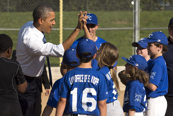 President Barack Obama greets players as he visits a little league baseball game at Friendship Park May 19, 2014 in Washington, DC
